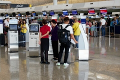 Self check-in terminals are available for most full service airlines in Terminal One.