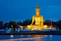 The 19 metre (62ft) Buddha of Wat Bang Chak on the opposite bank.
