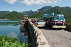 The dam  carries the Tai Tam Road along the top. From here you can get a bus or minibus to Stanley or to Quarry Bay.