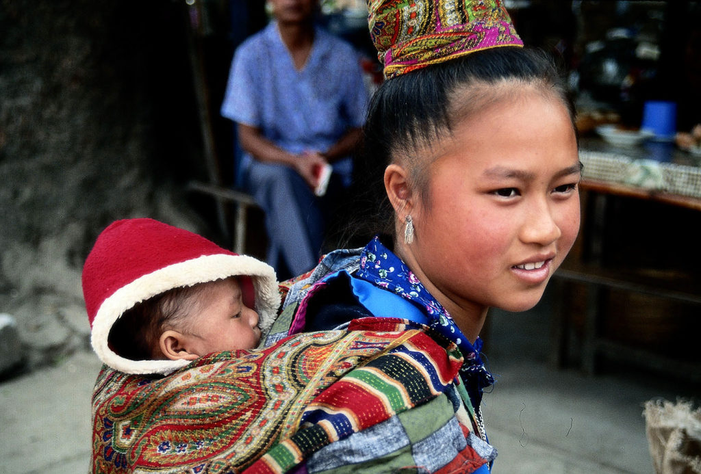 Hmong mother and baby at the market in Luang Prabang