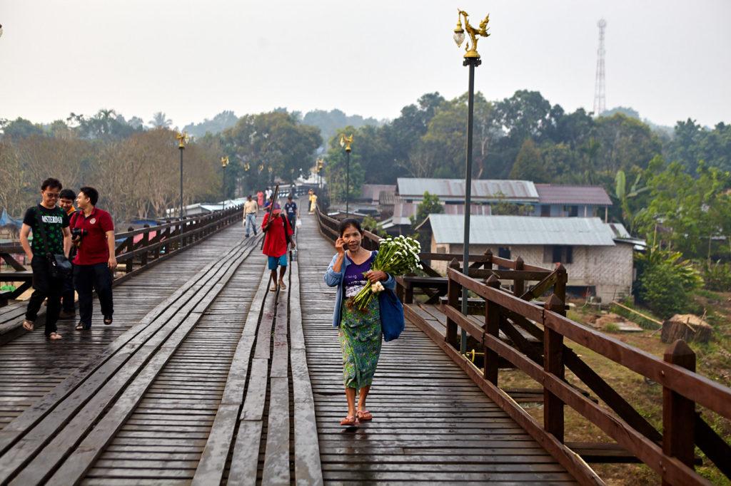 Walking across Uttamanusorn bridge, Sangkhlaburi, Thailand